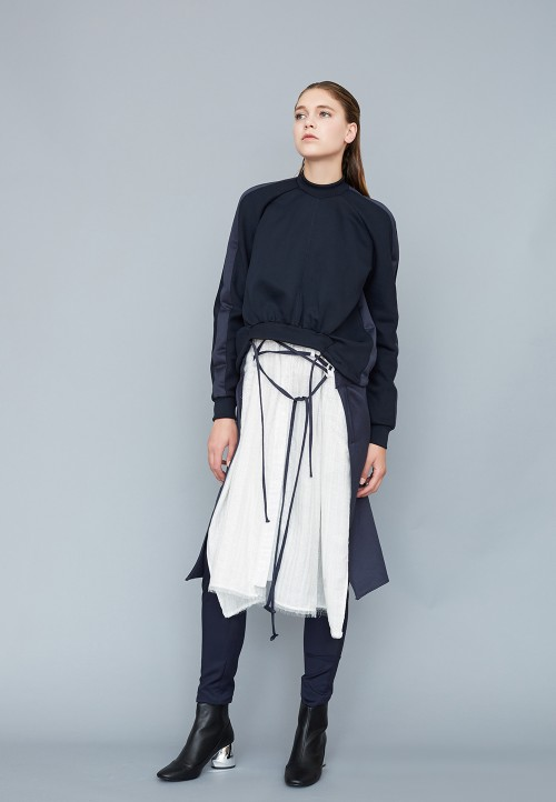 Low-necked, asymmetric and belted dress