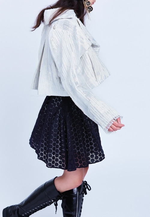 Asymmetric skirt with crossover pleats