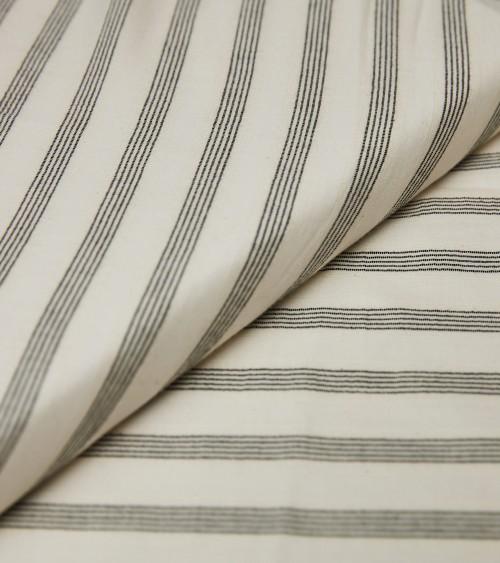 Black stripes off white...