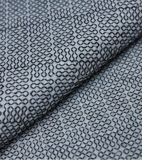 Black embroidered thread...